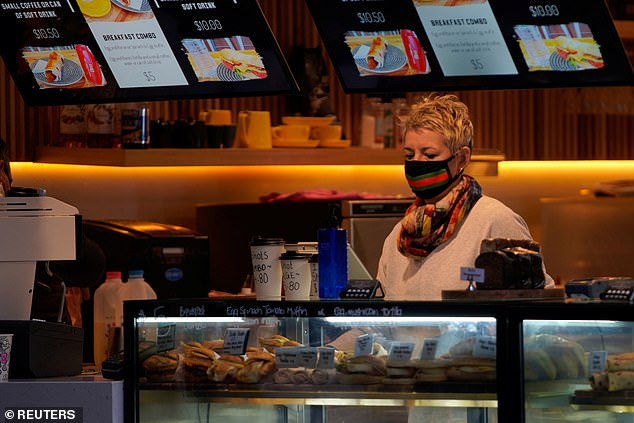 Millions of Australians may not get a payrise for years as the economy struggles to recover from the impact of coronavirus. Pictured: A cafe worker in Melbourne
