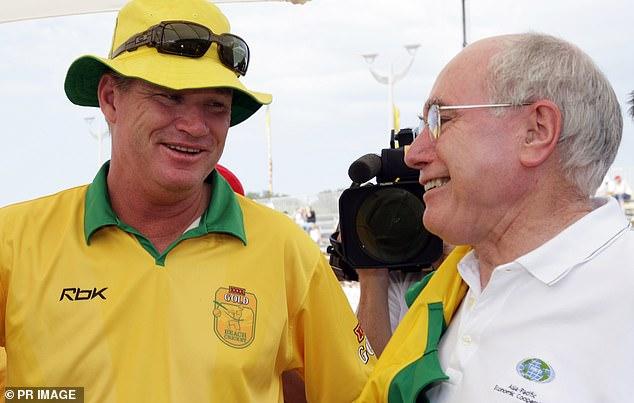 Jones speaks to former prime minister John Howard at Maroubra Beach in Sydney's eastern suburbs