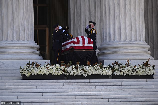 U.S. Supreme Court Police salute the casket of the late Supreme Court Associate Justice Ruth Bader Ginsburg as they place her remains on the building's front stairs for the public viewing