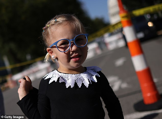 Lucille Wilson, 3, wears a RBG collar while waiting in line to view the casket of Ruth Bader Ginsburg