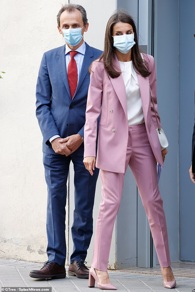 Queen Letizia, pictured with Pedro Duque today, last wore the stylish suit in March this year as she met with workers from the APRAMP charity which protects sex workers in Spain