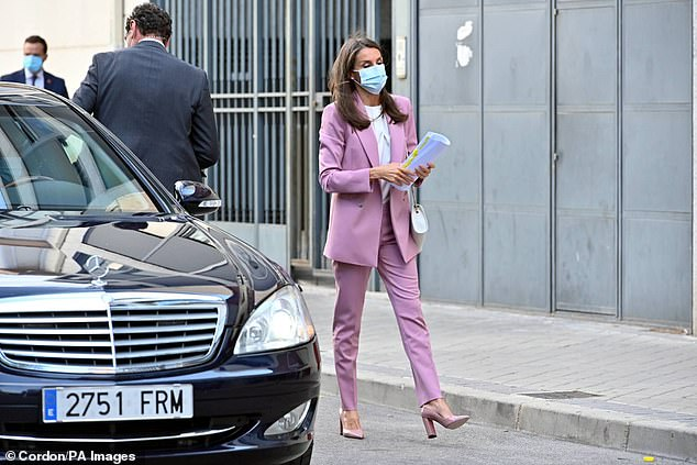 The royal, 48, oozed sophistication as she sported a Boss suit, featuring a double breasted pink blazer and matching tailored cigarette trousers