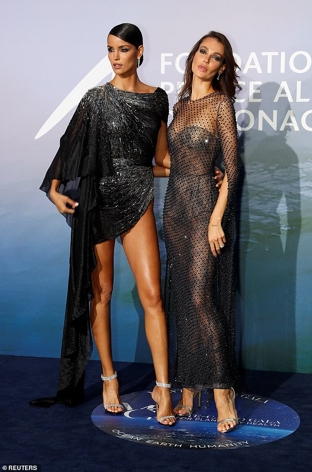 Pals:The French fashion star accessorised her look with metallic silver heels as she posed alongside Brazilian beauty Sofia Resing