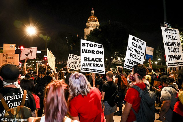 Protests erupted across the US (Denver pictured) following the decision on Wednesday to not indict the officers in the death of Breonna Taylor