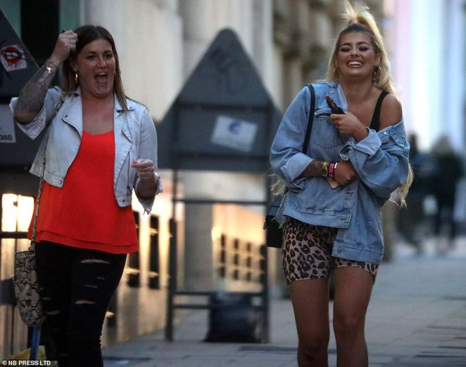 Women walked down a street in Leeds as they enjoyed an early evening out before all pubs and restaurants close by 10pm