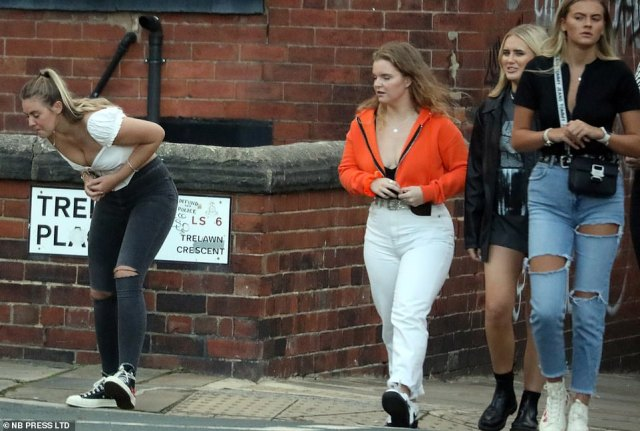 One girl in this group of four appeared to feel unwell as she walked with friends during a night out in Leeds earlier this evening