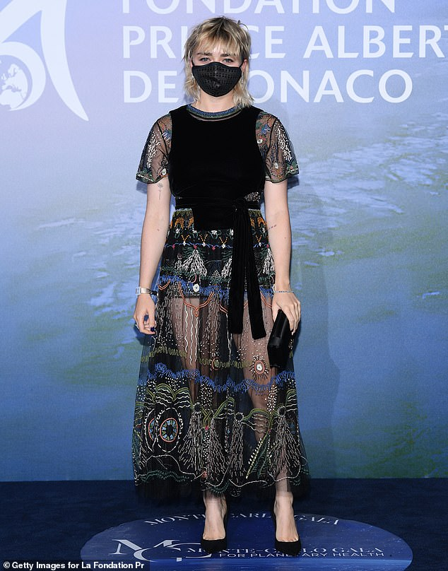 Standing out:The actress opted for an eye-catching dress with a sheer embroidered skirt and a velvet top
