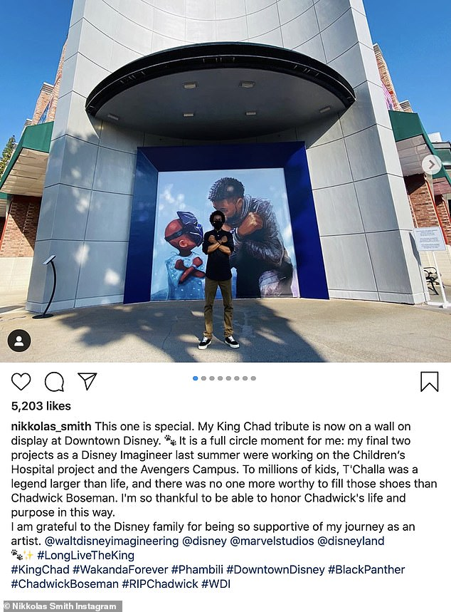 In memory: The tribute, which was created by concept artist Nikkolas Smith, showcases a young fan and Boseman exchanging the Wakanda salute, which involves crossing your arms in the shape of an X over your chest