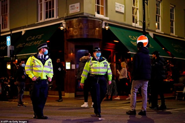 Customers enjoying a few drinks with friends on outside tables in Soho, central London, were forced to leave ahead of the Government's draconian curfew, widely seen by scientists as arbitrary