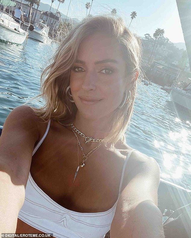 Lovely at sea: The photogenic wonder was seen in a bikini top as she took a selfie at sunset