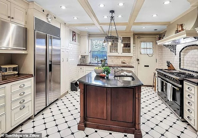 Airy: The kitchen has a central island, white cabinets, and subway tile