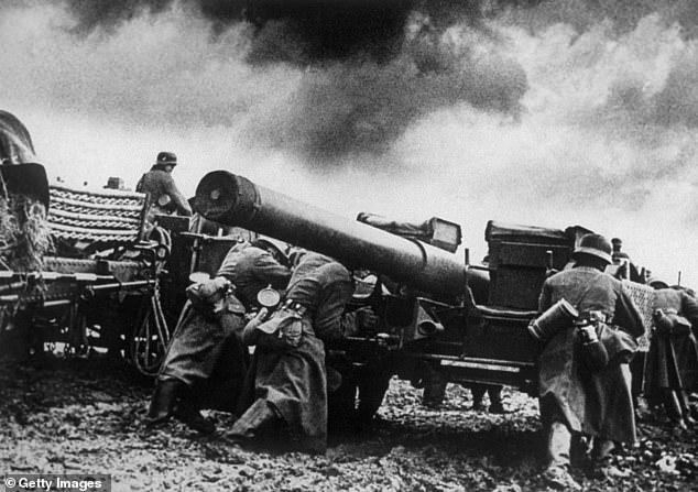 1940: Nazi troops setting up their big guns on one of the many battle fronts in Norway