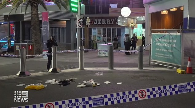 Police arrested a third person, a 24-year-old man from Surfers Paradise on Thursday and charged him with one count of murder and three counts of assault (pictured: scene were stabbing allegedly occurred)