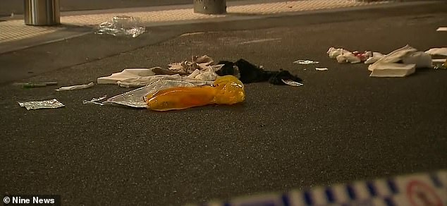 Pictures from the crime scene show blood stains, litter and clothes on the ground, which may have been where the injured man was treated