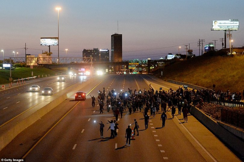A large crowd of dozens of protesters block several lanes of Interstate 64 in St. Louis, Missouri, on Thursday