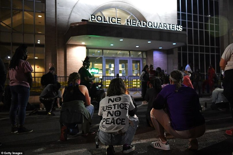 Anti-racism protesters gather outside police headquarters in St. Louis, Missouri, on Thursday evening
