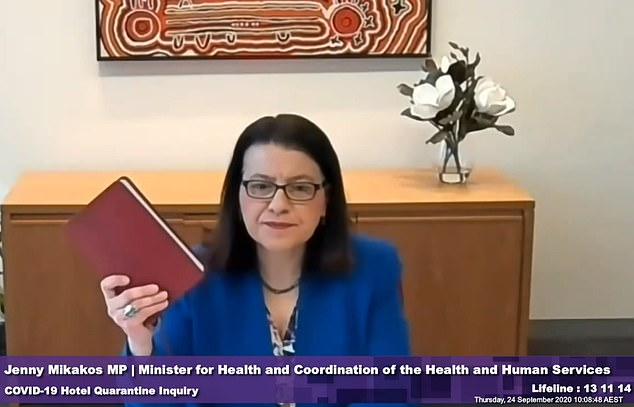 At an inquiry in the bungled quarantine program on Thursday, Ms Mikakos (pictured taking the oath) recalled she did not know private guards were enforcing the scheme until late May