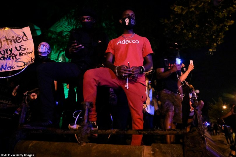 More than 1,000 people defied a second night of curfew in the US city of Louisville to protest over the lack of criminal charges in the police killing of Breonna Taylor, with some seeking refuge in a church