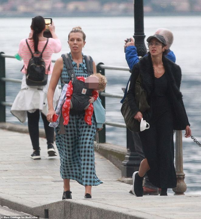 Carrie Symonds, 32, was seen strolling along a waterfront promenade with a friend while carrying son Wilfred in a baby sling
