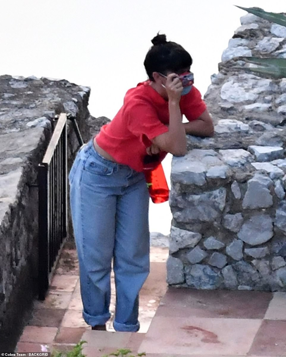 Bold: One of the group with Harry donned a bright red t-shirt and denim jeans which she turned up at the cuffs