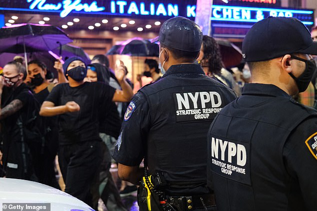 Shea said the budget cuts, which were voted on by the New York City Council back in July, has had a 'significant impact' on the crime surge over the summer. Officers are pictured above in early September during BLM protests