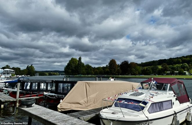 The topsy-turvy British weather lived up to its reputation overnight as some areas were left looking decidedly wintery following hail and snow showers less than 48 hours after the end of a September heatwave. Dark clouds rumble in over the River Thames at Henley on Thames, Oxfordshire