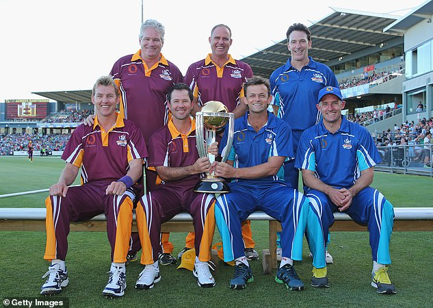 Former Australian Cricket World Cup players Dean Jones, Brett Lee, Michael Hussey, Ricky Ponting, Matthew Hayden, Damien Fleming and Adam Gilchrist pose with the the ICC Cricket World Cup trophy during the Ricky Ponting Tribute Match at Aurora Stadium on January 30, 2014