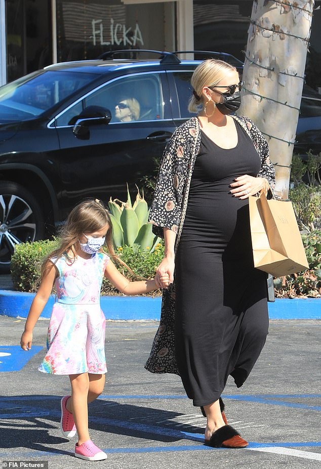 Mom on the go:Ashlee Simpson was seen Friday in affluent Bel-Air, parading her very pregnant belly while shopping at kid's clothing boutique Flicka with her daughter Jagger Snow