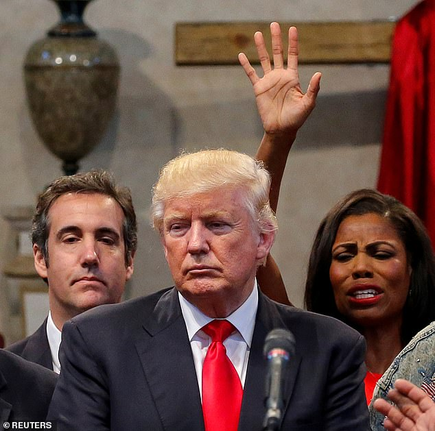 Omarosa is pictured with Michael Cohen and President Trump at an Ohio church during the 2016 Presidential campaign