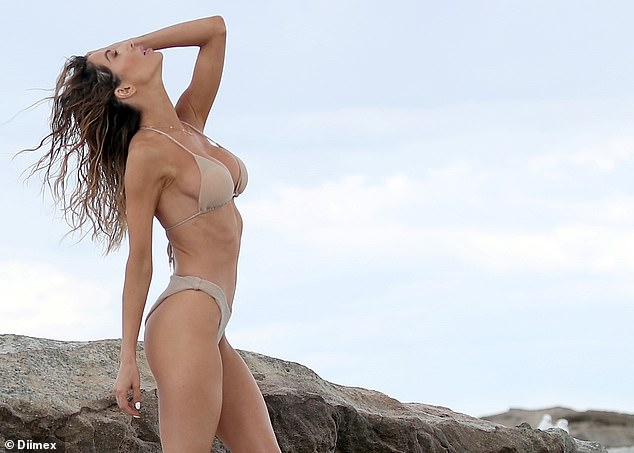 Busting out: The brunette beauty's skimpy bikini could barely contain her curves