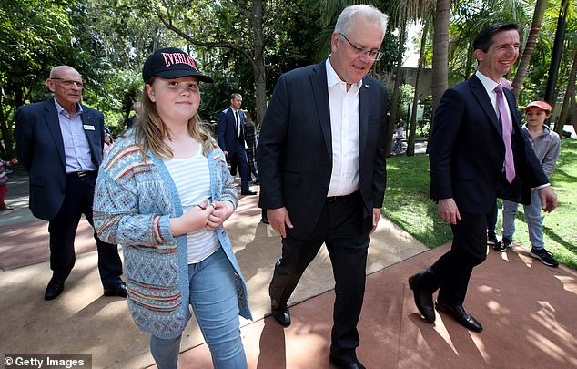 MrMorrison with his daughter Lily Morrison and Senator Simon Birmmingham during a visit to the Adelaide Zoo on September 26