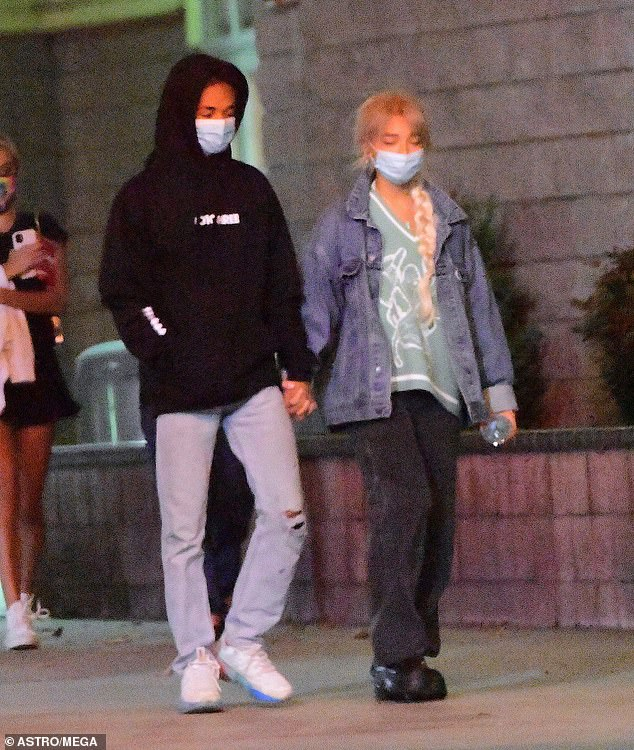 Loved up:Will Smith's son sparked romance rumours with model Sab, 21, as they were seen holding hands on a romantic movie date night in Los Angeles last weekend