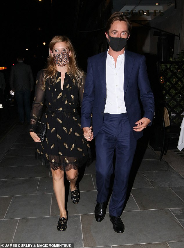 Her sister Princess Eugenie revealed she was pregnant yesterday, and Princess Beatrice (pictured with her husband) has been spotted no doubt celebrating the announcement