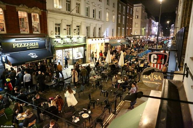 Crowds were out on Saturday night in trendy Soho in the West End of London ahead of the new curfew at 10pm
