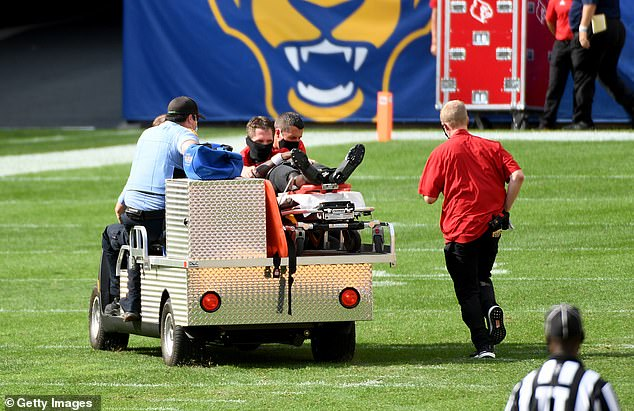 Cunningham is carted off the field by paramedics after being injured on a play in the fourth quarter