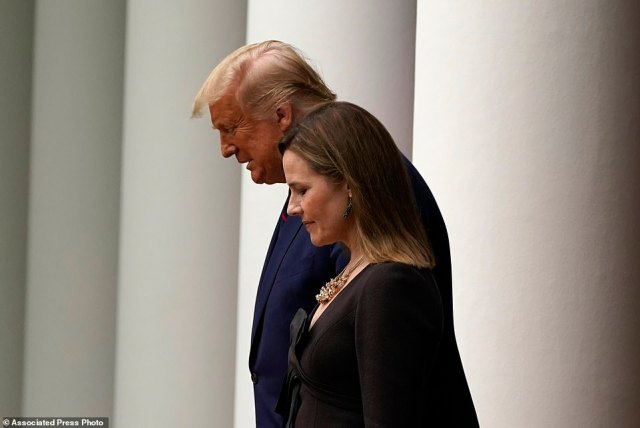 President Donald Trump walks with Judge Amy Coney Barrett to a news conference to announce Barrett as his nominee to the Supreme Court, in the Rose Garden at the White House on Saturday