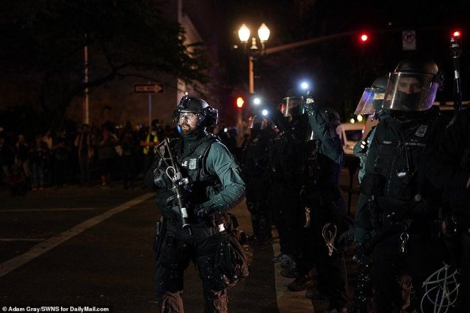 Police were seen in full body armor and riot gear as they prepared to deal with protesters
