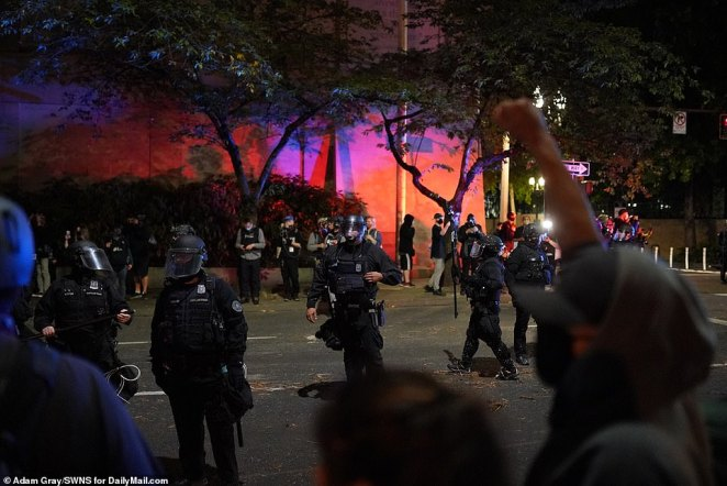 Officers plan what to do next as protests intimidate and make threatening gestures