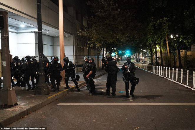 Police sought to clear the streets of protesters as the night drew on