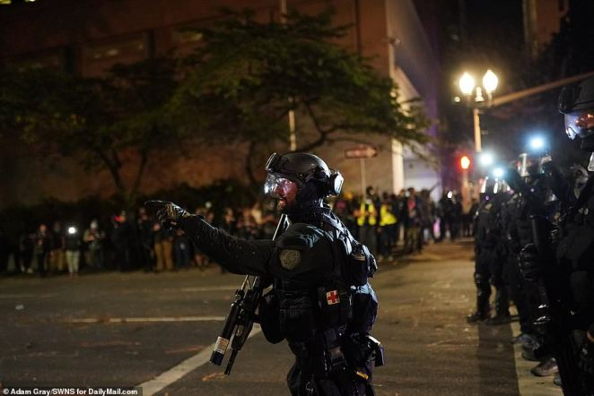 One officer yells out instructions and police prepared for a confrontation with protesters
