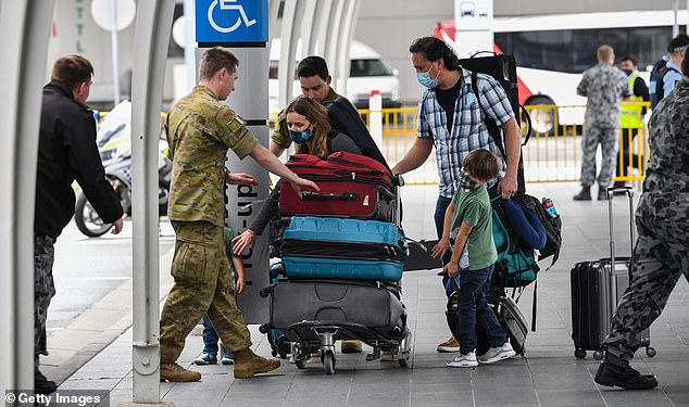Pictured are passengers at Sydney International Airport on September 18 after flying in from Auckland