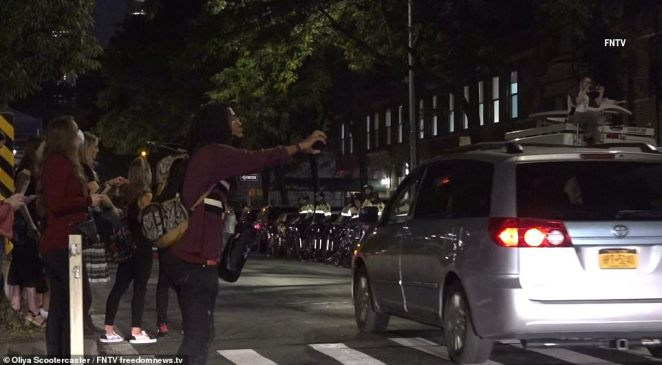 Bystanders attempted to take footage with their cellphones as the melee was continuing