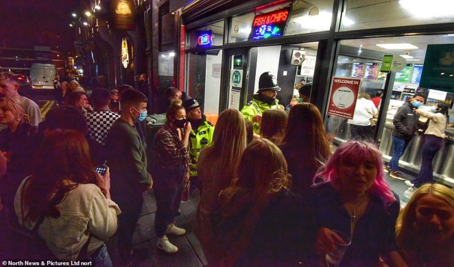 Police officers move in at 10pm to stop anymore revellers entering the takeaway in the Bigg Market in Newcastle city centre