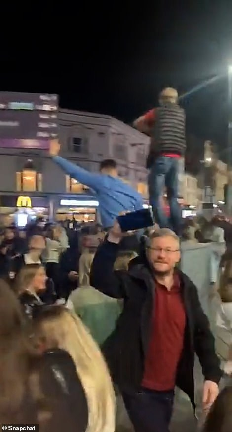 Revellers were seen jumping and chanting. Some people filmed the gathering