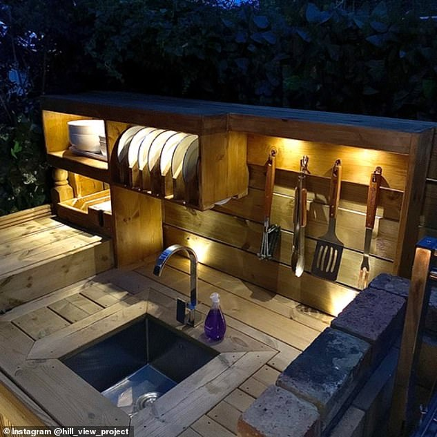 The DIY-loving dad ended up building an outdoor kitchen which boasted an impressive brick and wood BBQ and plenty of seating to entertain guests