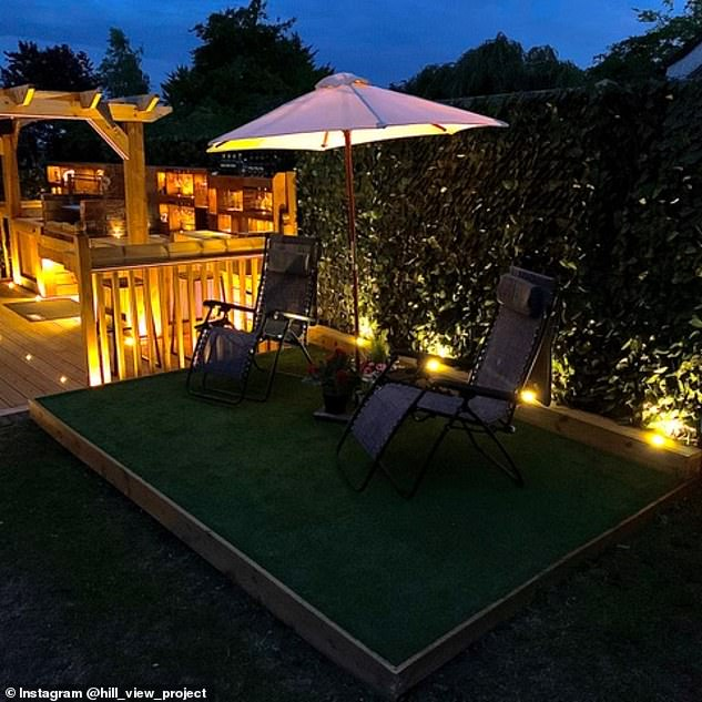Also included in his new outdoor space is a nifty seating area complete with a sun umbrella and stylish lighting
