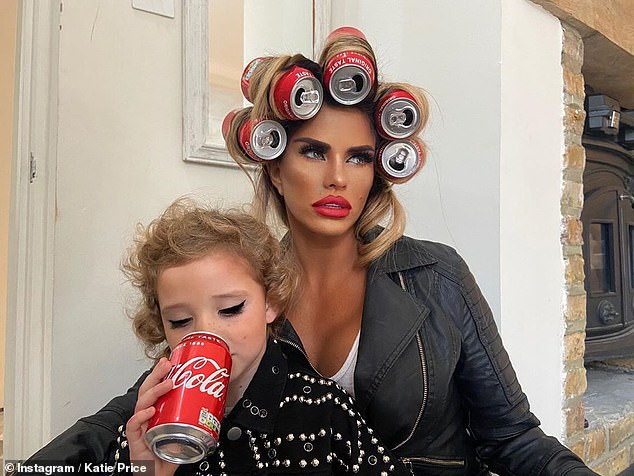 Pin-up: In snaps from August, the blonde used Coca-Cola cans as hair rollers while Bunny sipped the drink