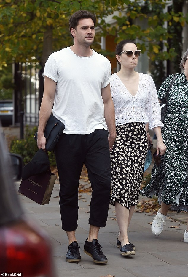 Heading out: Daisy walked inbetween her mum and her beau