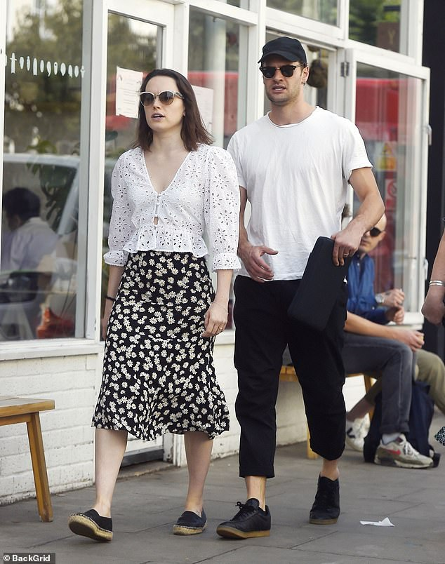 Style: The star's white shirt came in at the waist to accentuate her slim figure and boasted puffed sleeves