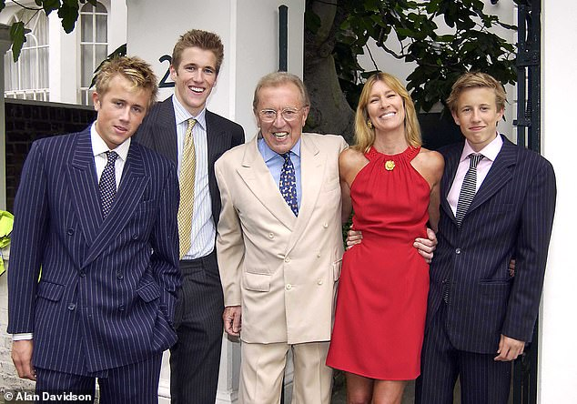 Sir David with wife Lady Carina Frost and their sons Miles, Wilfred and George outside their home in Chelsea, London